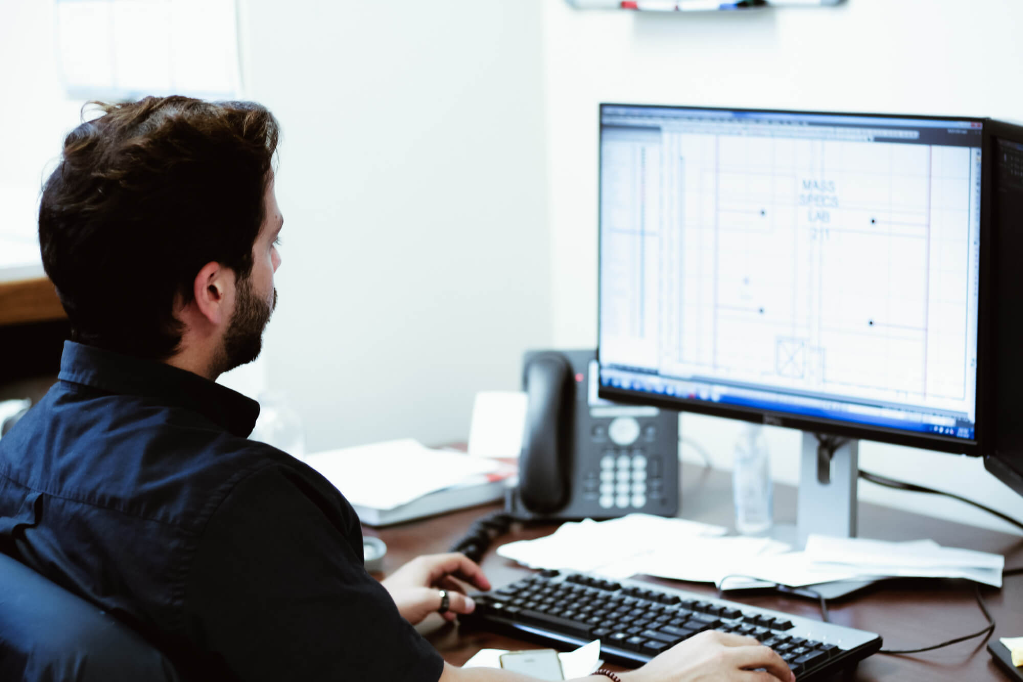 team member designing on computer